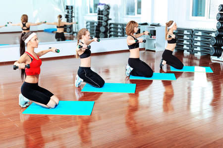 Group of young women in the gym centre. Stock Photo - 9524398