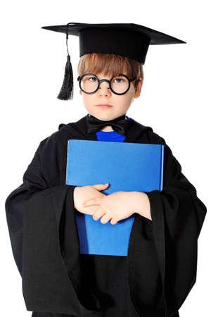 genius: Cute little boy in graduation gown Stock Photo