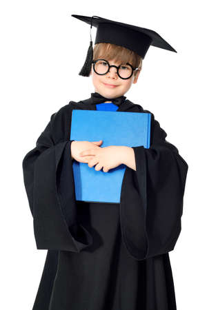 book boy: academic, achievement, blonde, book, boy, cap, caucasian, ceremony, child, college, completed, cute, degree, education, elementary, future, generation, genius, glasses, gown, grad, graduate, graduating, graduation, happiness, happy, intelligent, isolated, Stock Photo