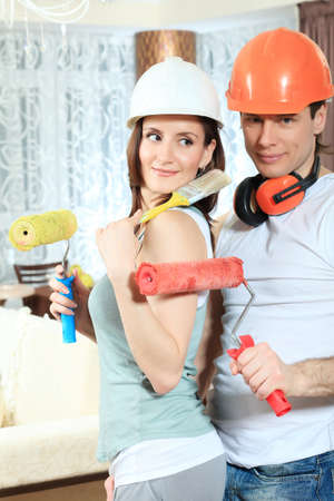 Happy family making repairs at their new home. Stock Photo - 9524705