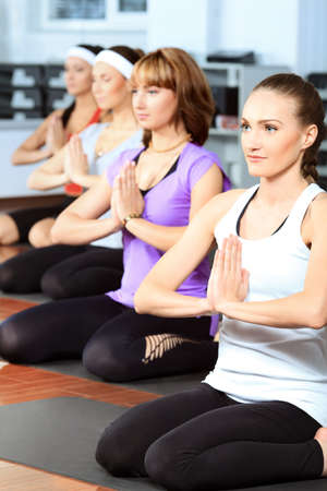 Group of young women in the gym centre. Yoga. photo