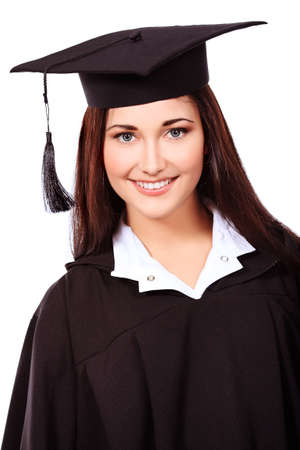 Educational theme: graduating student girl in an academic gown. Isolated over white background. photo