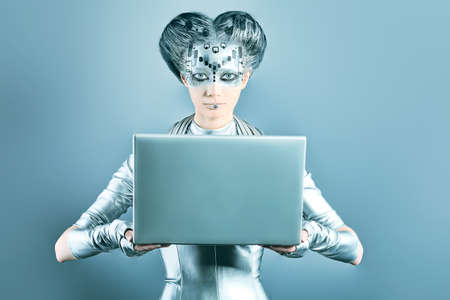Shot of a futuristic young woman with a laptop.  Stock Photo - 9620518