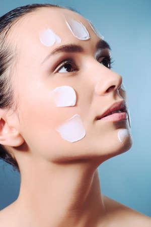 Portrait of beautiful spa girl with cream on her face. Stock Photo - 9620564