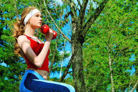 spring training: Young sporty woman is working out outdoor.