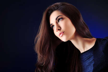 Portrait of a beautiful young woman brunette. Stock Photo - 9631100