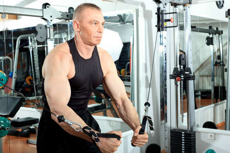 Mature sporty man in the gym centre. Stock Photo - 9631154