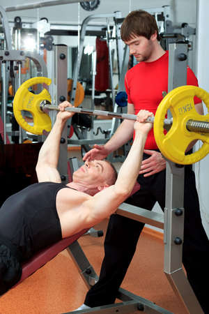 Sporty men in the gym centre. Stock Photo - 9631153