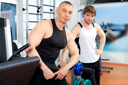 health clubs: Sporty men in the gym centre. Stock Photo