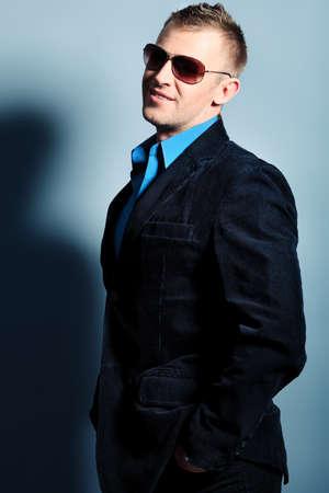 homem: Portrait of a handsome man in a suit. Studio shot.