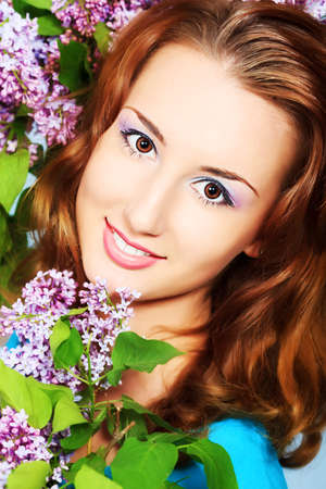 Portrait of a beautiful spring girl in lilac flowers. Stock Photo - 9631240