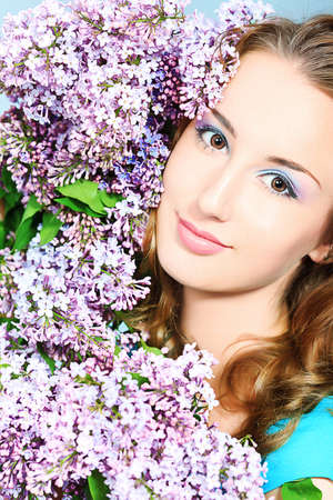 Portrait of a beautiful spring girl in lilac flowers. Stock Photo - 9631251