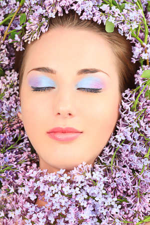 Portrait of a beautiful spring girl in lilac flowers. Stock Photo - 9631227