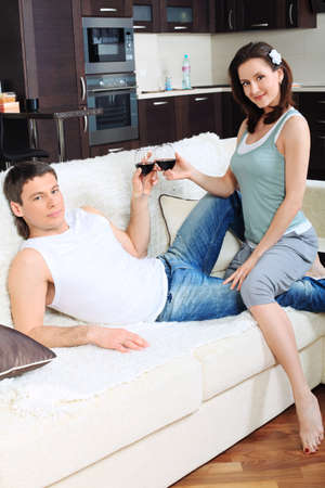 Happy married couple having a rest at home. Stock Photo - 11692227