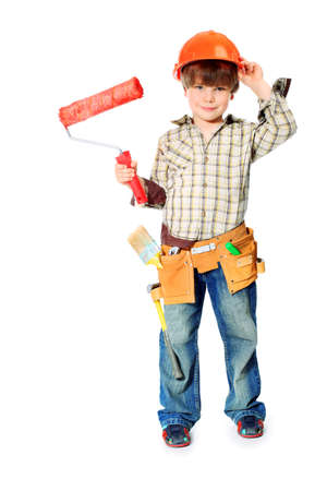 Little boy with helmet and tools. isolated on white.  photo