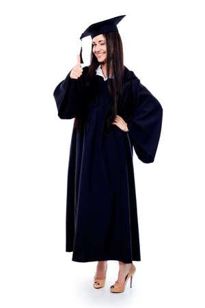 birrete de graduacion: Tema educativo: graduaci�n chica estudiante en un vestido acad�mico. Aislados sobre fondo blanco.