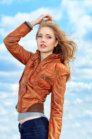 Beautiful young woman outdoors over blue sky. Stock Photo - 9686004