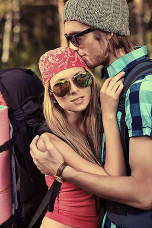 backpacking: Couple of tourists making their journey at the mountains. Stock Photo