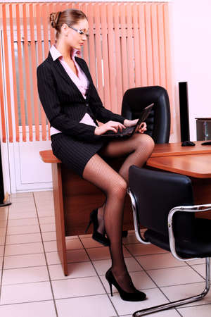 Attractive business woman is working at the office. Stock Photo - 9692300
