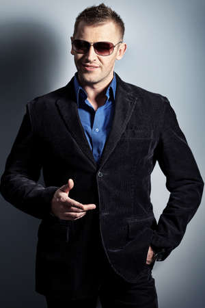 Portrait of a handsome man in a suit. Studio shot. photo
