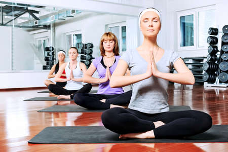 Group of young women in the gym centre. Yoga. Stock Photo - 9692320