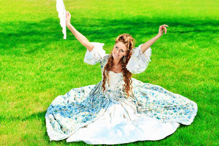 Beautiful young woman in medieval era dress on a sunny day outdoor. Stock Photo - 9686074