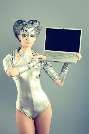 Shot of a futuristic young woman with a laptop.  photo