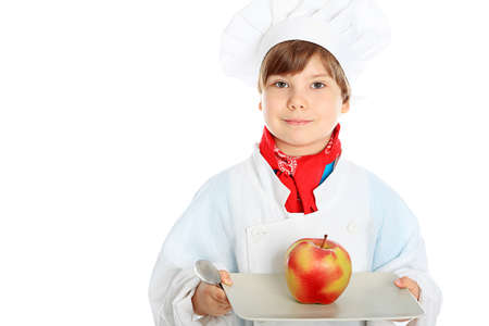 Little smiling chief-cooker with apple, isolated on white photo