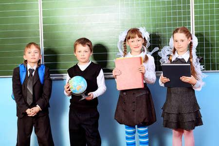 Schoolchildren at a classroom. Education. Stock Photo - 9773511