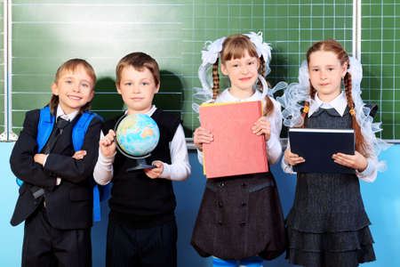 Schoolchildren at a classroom. Education. Stock Photo - 9773504