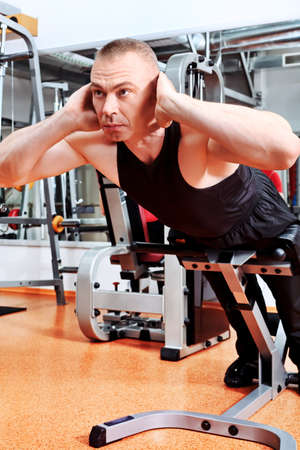 back training: Mature sporty man in the gym centre. Stock Photo
