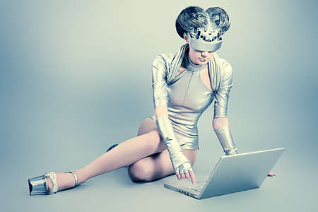 technology metaphor: Shot of a futuristic young woman with a laptop.  Stock Photo