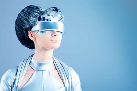 technology metaphor: Shot of a futuristic young woman wearing glasses.  Stock Photo