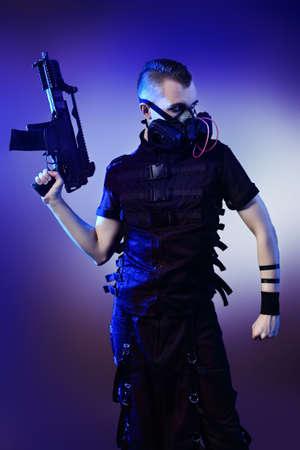 Shot of a conceptual man in a respirator holding a gun.  Stock Photo - 9774945