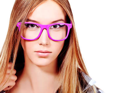 glasses model: Portrait of a girl teenager in a big pink glasses. Isolated over white background. Stock Photo