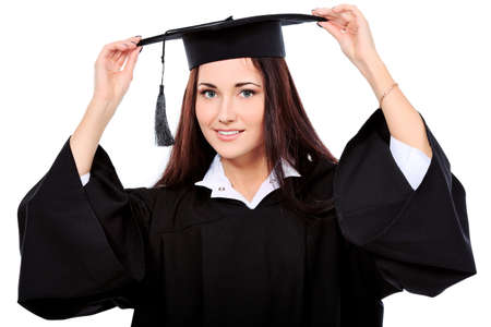 finishing school: Educational theme: graduating student girl in an academic gown. Isolated over white background.