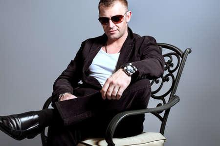 Portrait of a handsome man in sunglasses. Studio shot. Stock Photo - 9784347