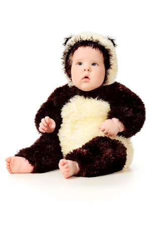 carnival costume: Beautiful baby in panda costume. Isolated over white.