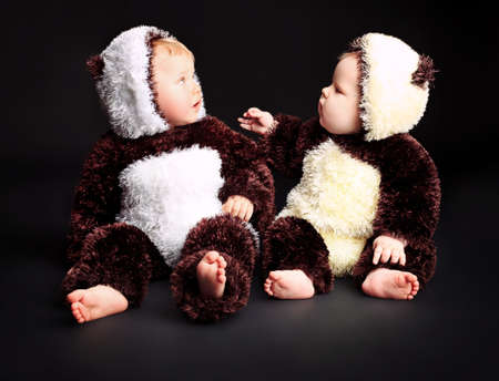 Beautiful babies in panda costume. Shot in a studio. photo