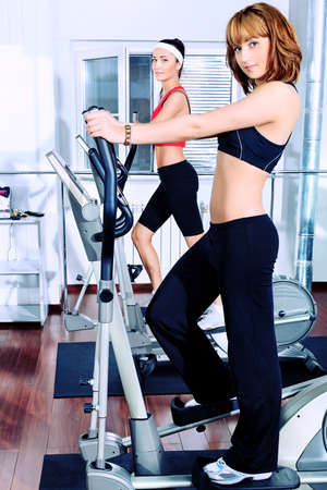 Two young women in the gym centre.  photo