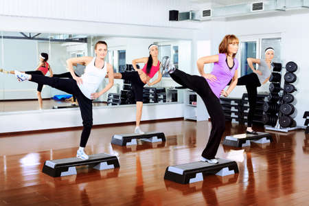 Group of young women in the gym centre. Imagens