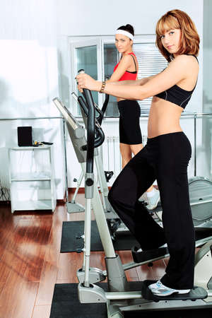 Two young women in the gym centre. Stock Photo - 9837221