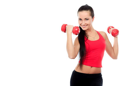dumbbells: Shot of a sporty young woman with dumbbells. Active sporty life, wellness.