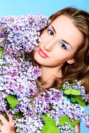 Portrait of a beautiful spring girl in lilac flowers. Stock Photo - 9837280