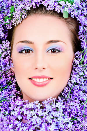 Portrait of a beautiful spring girl in lilac flowers. Stock Photo - 9837094