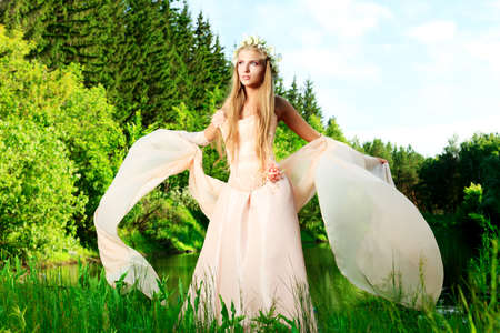 Portrait of a dreamy fairy girl outdoor. Stock Photo - 9837273