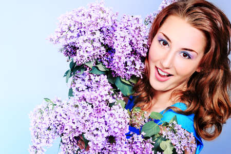 Portrait of a beautiful spring girl in lilac flowers. photo