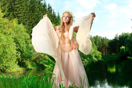 Portrait of a dreamy fairy girl outdoor. Stock Photo - 9837270
