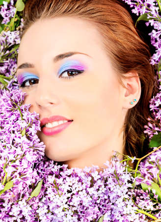 Portrait of a beautiful spring girl in lilac flowers. Stock Photo - 9837090