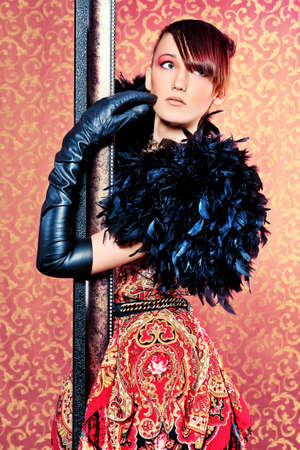 leather glove: Fashion shot of a beautiful model over vintage background.